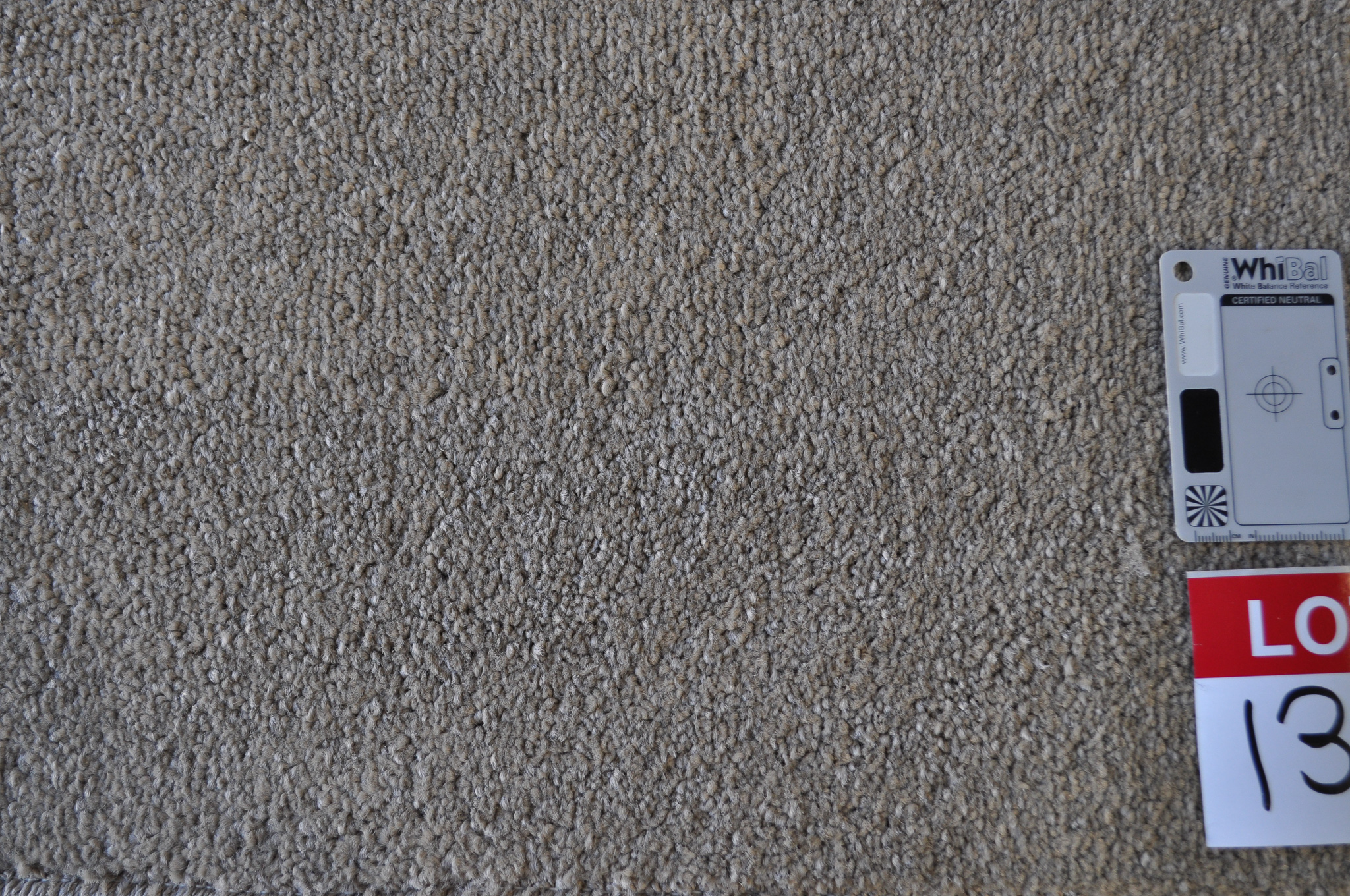 grey colored, twist pile roll of carpet on sale at Concord Floors, it being a remnant roll in Concord Floor's warehouse.