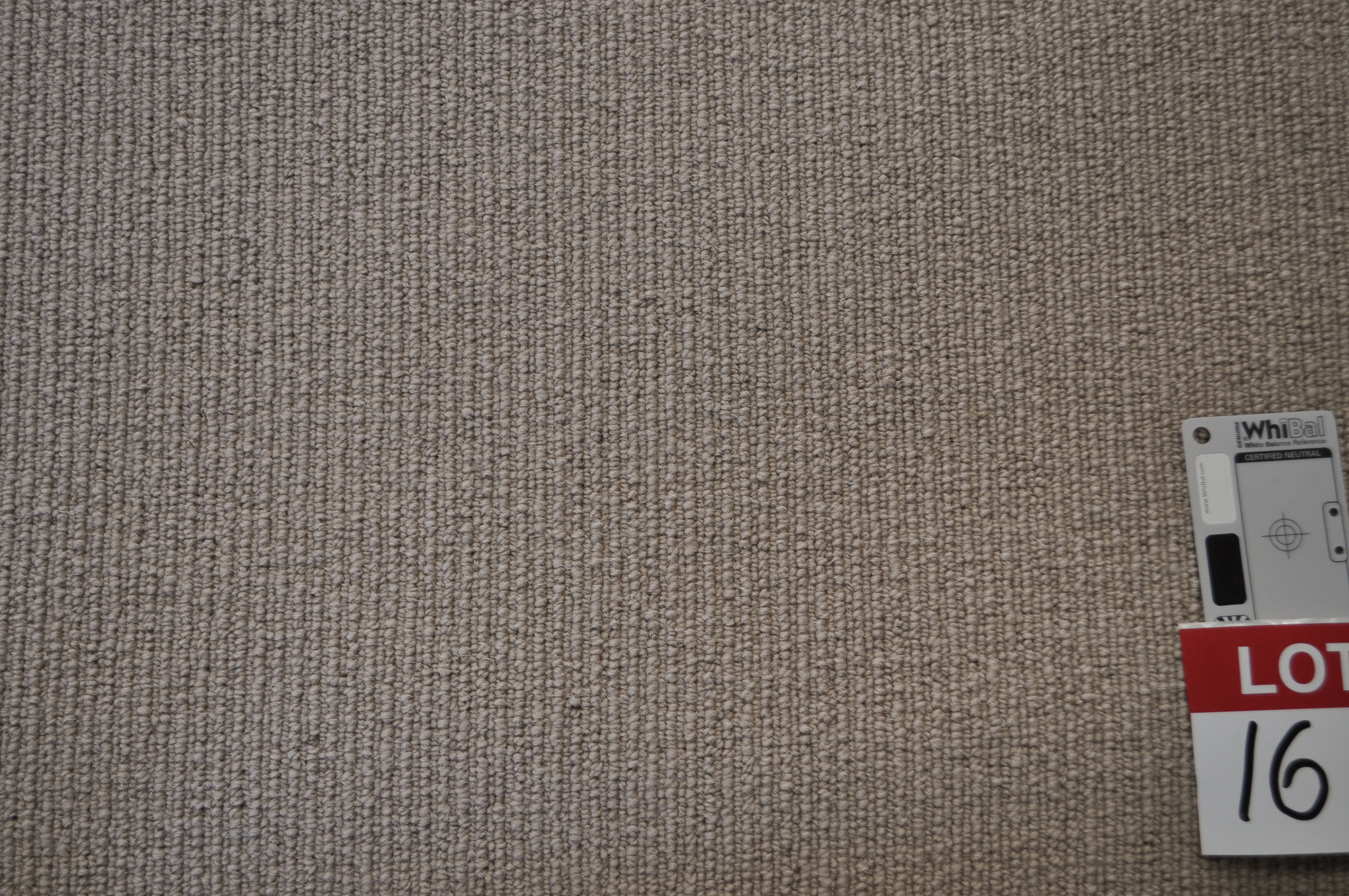 dark beige colored, sisal type, roll of carpet on sale at Concord Floors, it being a remnant roll in Concord Floor's warehouse.