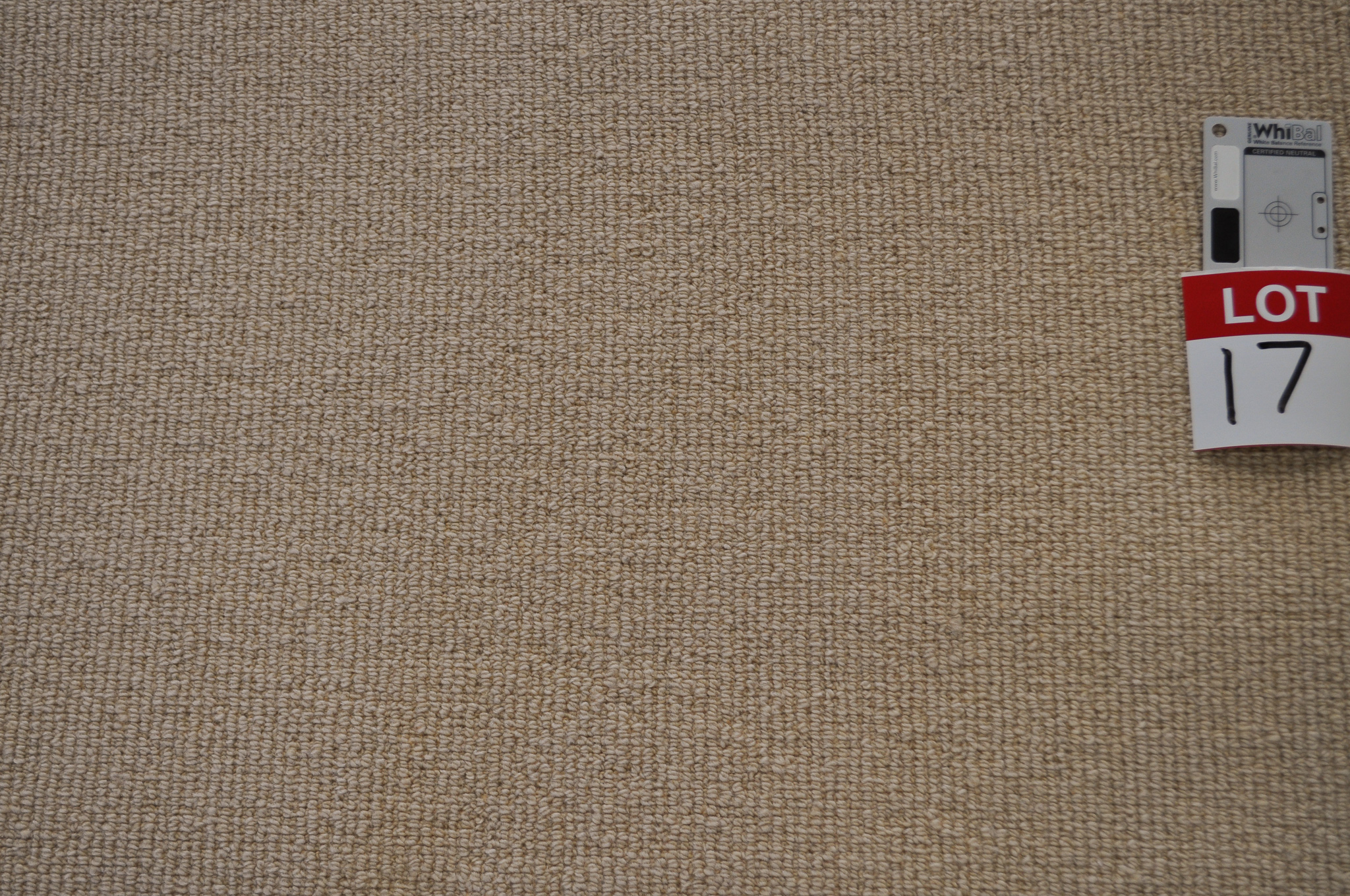 yellow beige colored, sisal pile, roll of carpet on sale at Concord Floors, it being a remnant roll in Concord Floor's warehouse.