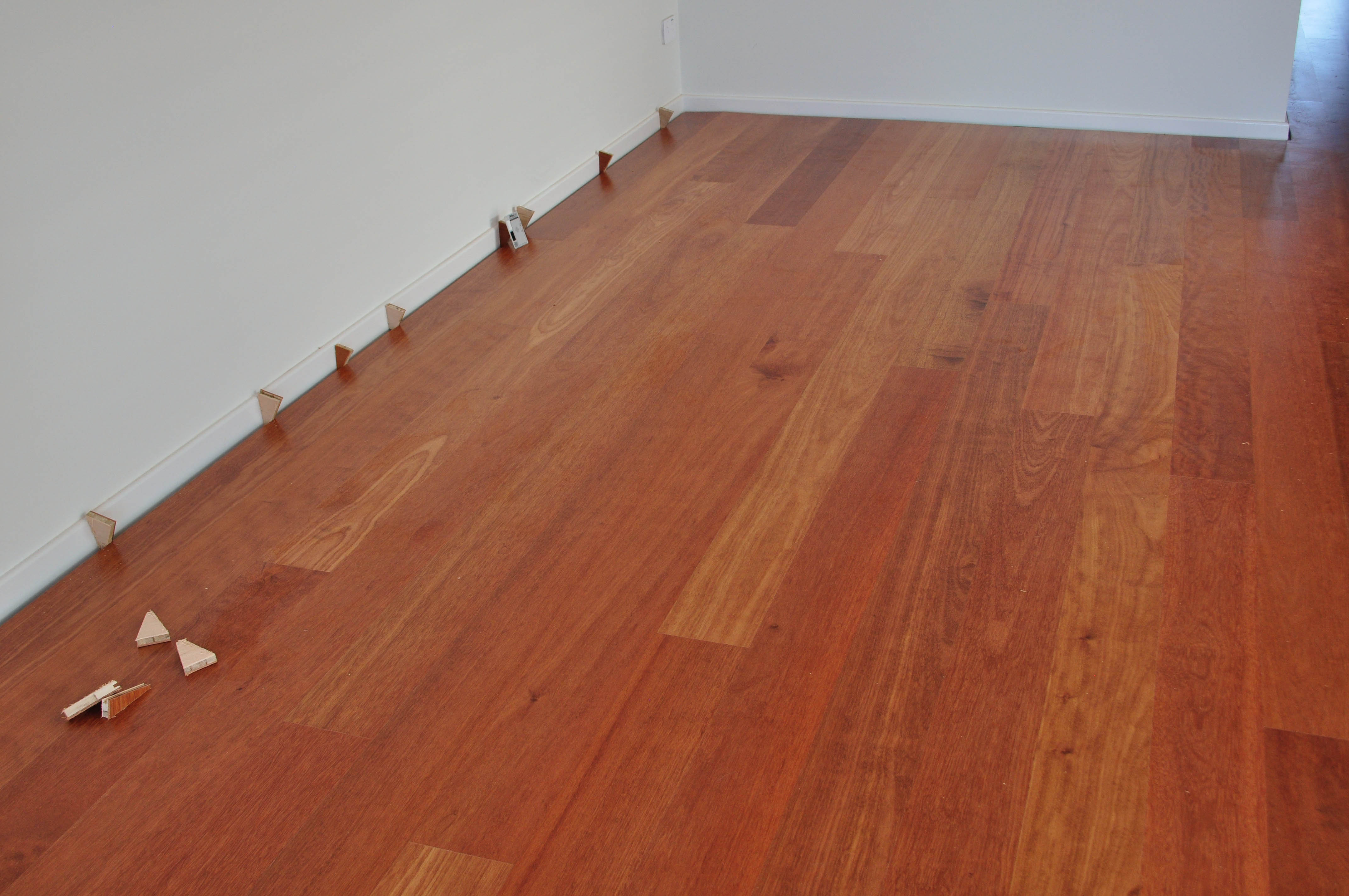 Showing a kempes hardwood timber floor  being installed by Concord Floors in a home in Melton