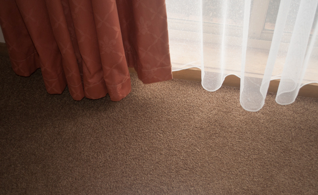tan colored,nylon twist-pile carpet installed in a room in the suburb of Melton Vic 3337 by Concord Floors.