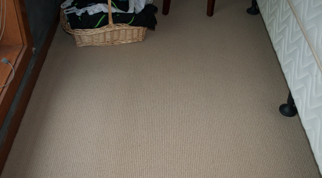 pink colored, sisal-pile carpet installed in a room in the suburb of Melton Vic 3337 by Concord Floors.