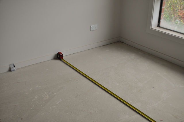 a room being measured widthwise for carpet laying by Concord Floors in a house in Werrbee, Vic. 3030.