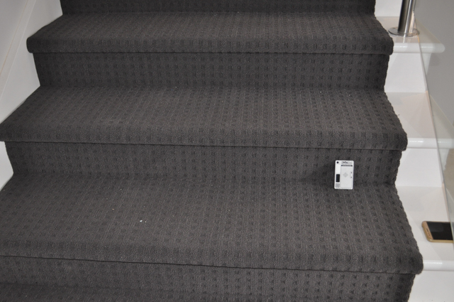 a staircase carpeted by Concord Floors, with charcoal colored, patterned carpet in a house in Melton, Vic. 3337.