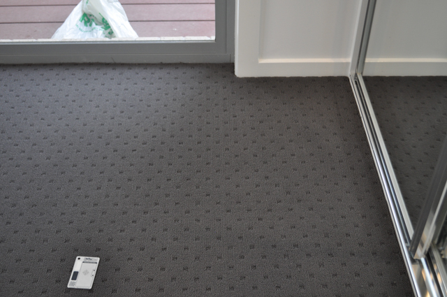 a room carpeted by Concord Floors, with charcoal colored, patterned carpet in a house in Altona, Vic. 3018.