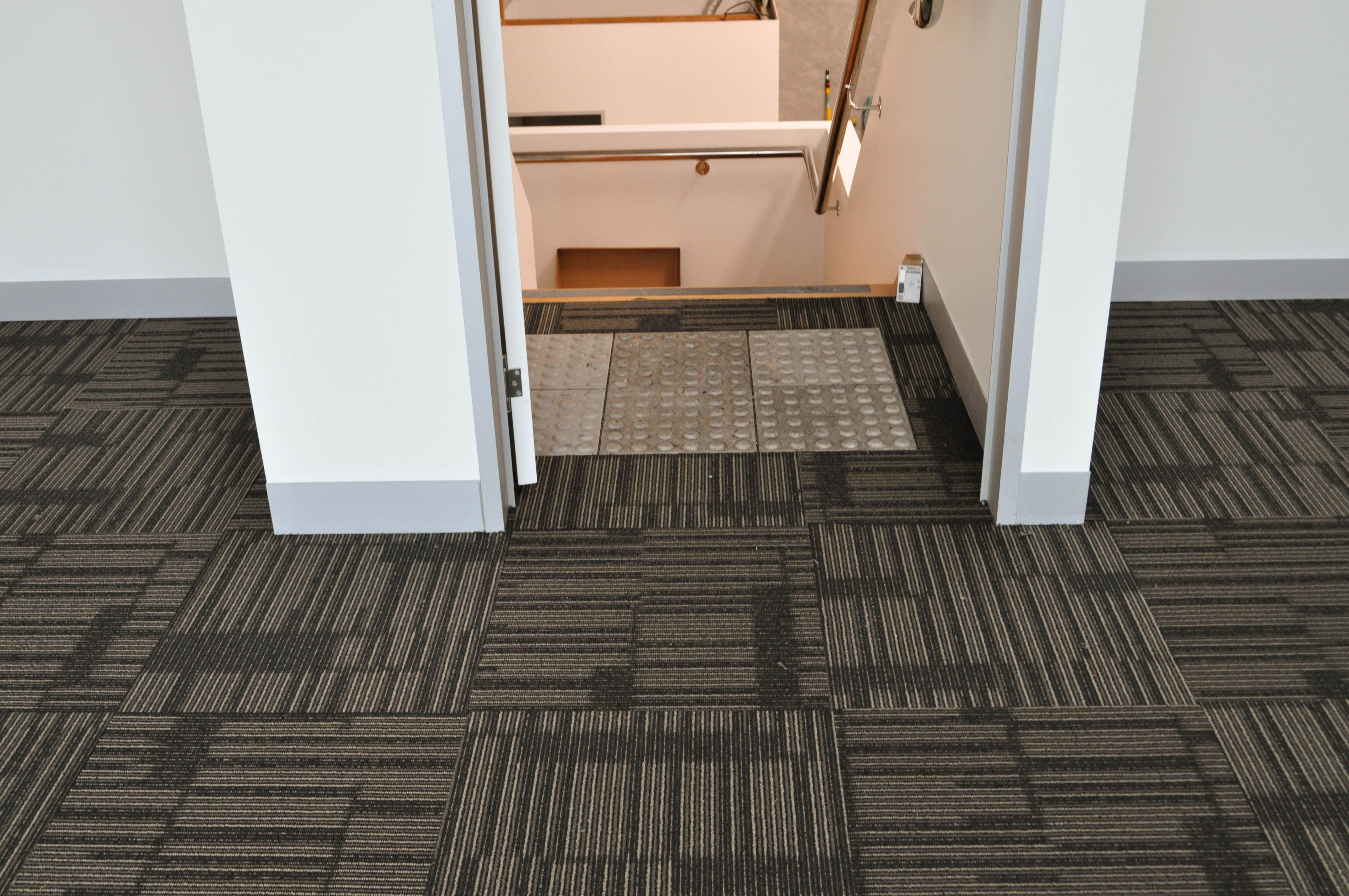 Showing a floor that has a patterned carpet tile installed by Concord Floors on it. The building is in Derrimut.