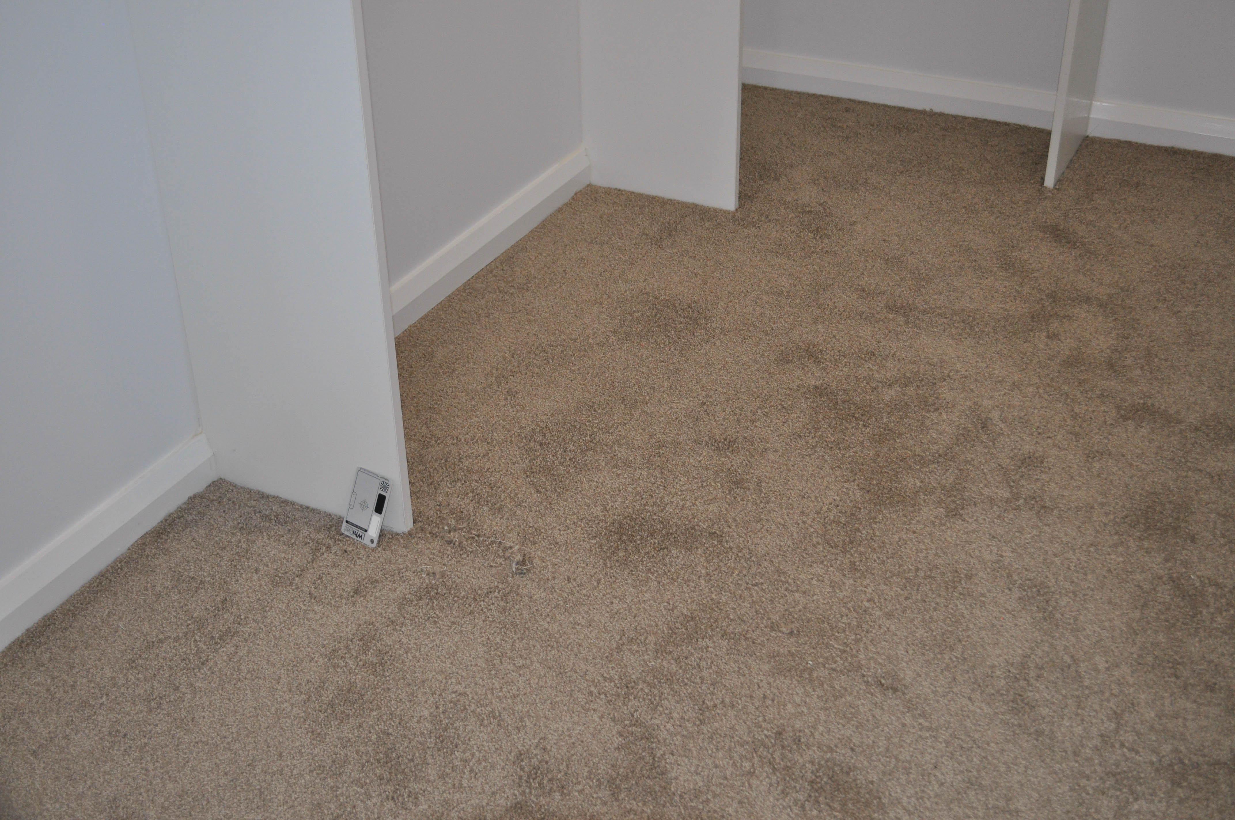 shows the carpet, of a light brown color, in a brand new home built by a volume builder for a client in the 